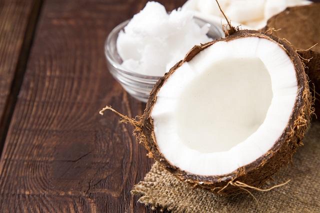 bigstock Coconut With Coconut Oil In Ja 173590901