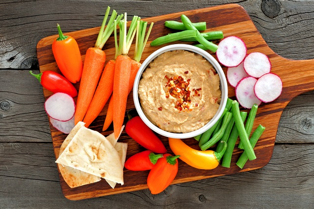 bigstock Hummus Dip With A Serving Plat 177273304