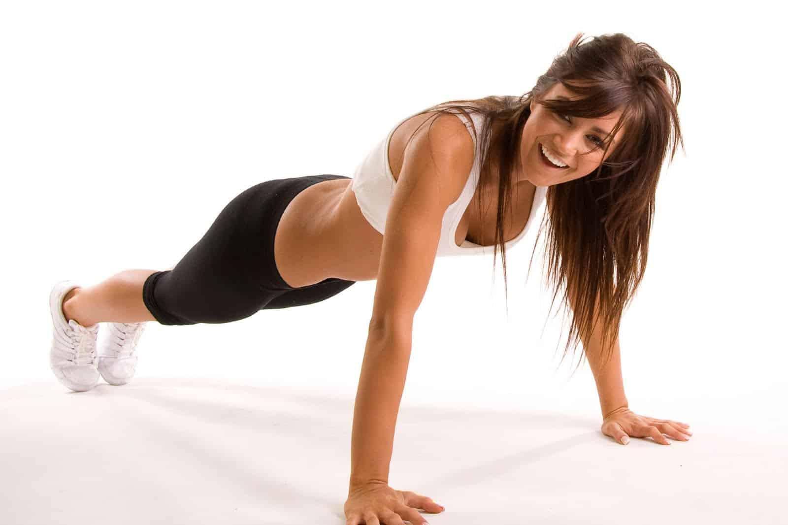 woman push ups happy